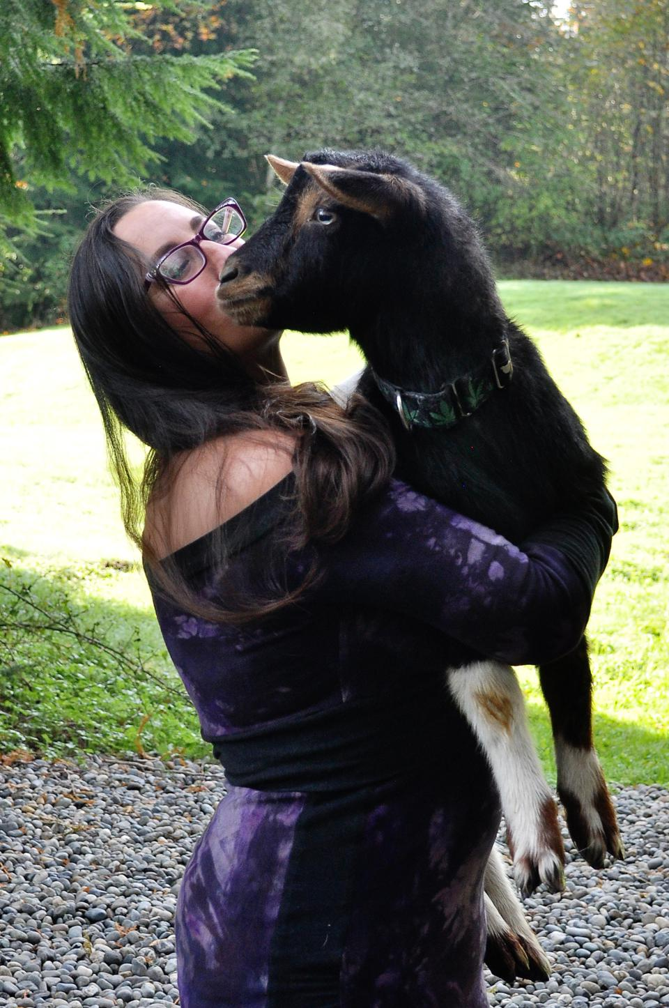 Tracy Rice, owner of Treehouse Joint, with one of her goats that free roams the property.