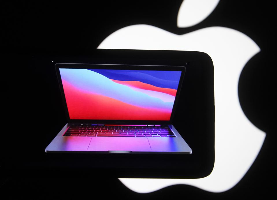 In this photo illustration the new MacBook Pro seen on a...