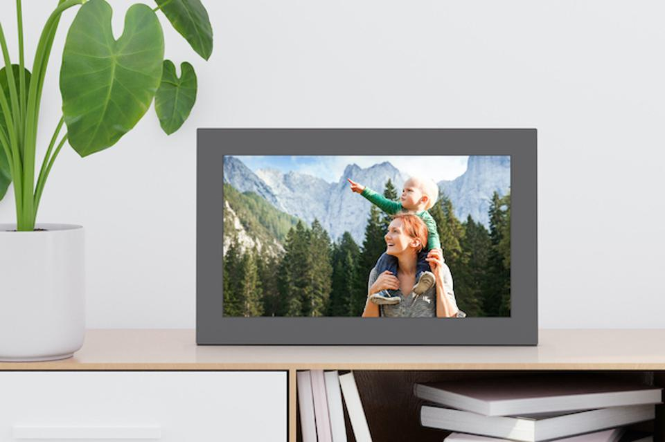 The Meural digital frame showcases a playlist of travel photos.