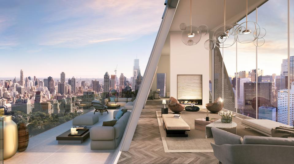 A living room and terrace overlooking the Manhattan skyline.