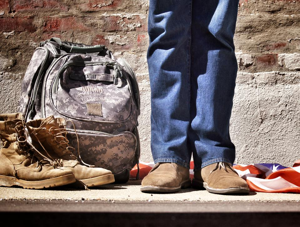 Veteran standing near shoes