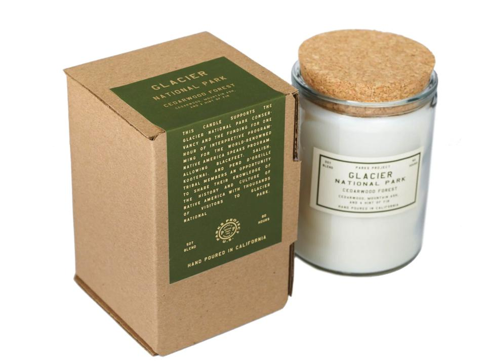 A Glacier National Park scented candle and packaging