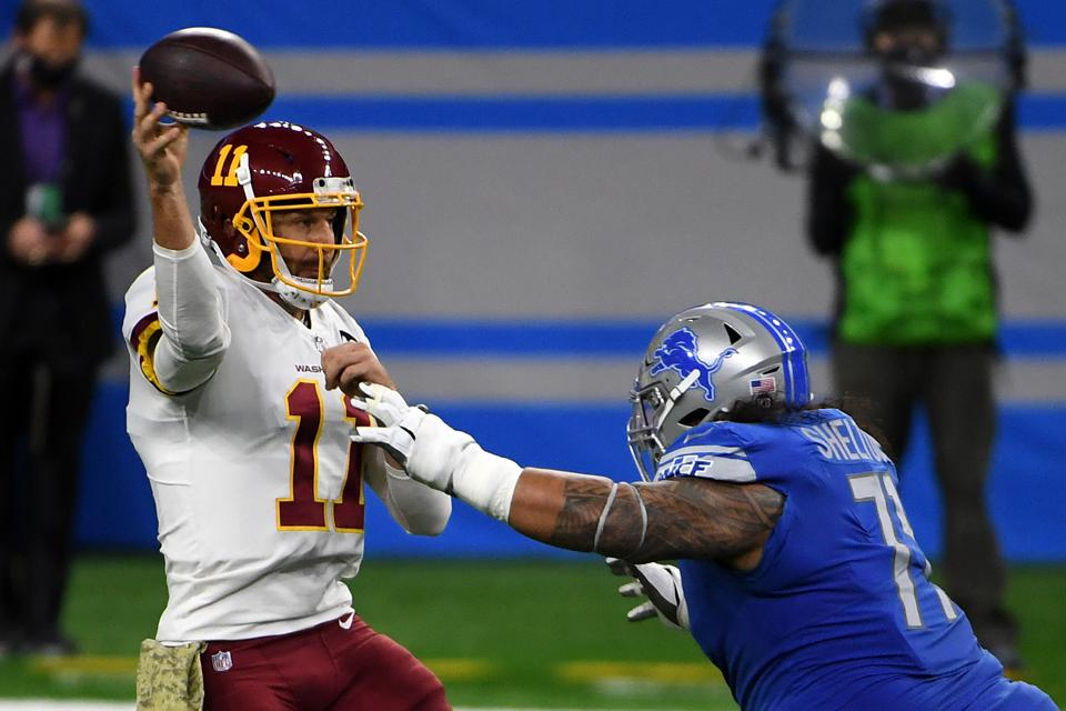Danny Shelton #71 of the Detroit Lions attempts to sack Alex Smith #11 of the Washington Football Team during their game at Ford Field on November 15, 2020 in Detroit, Michigan. (Photo by Nic Antaya/Getty Images)