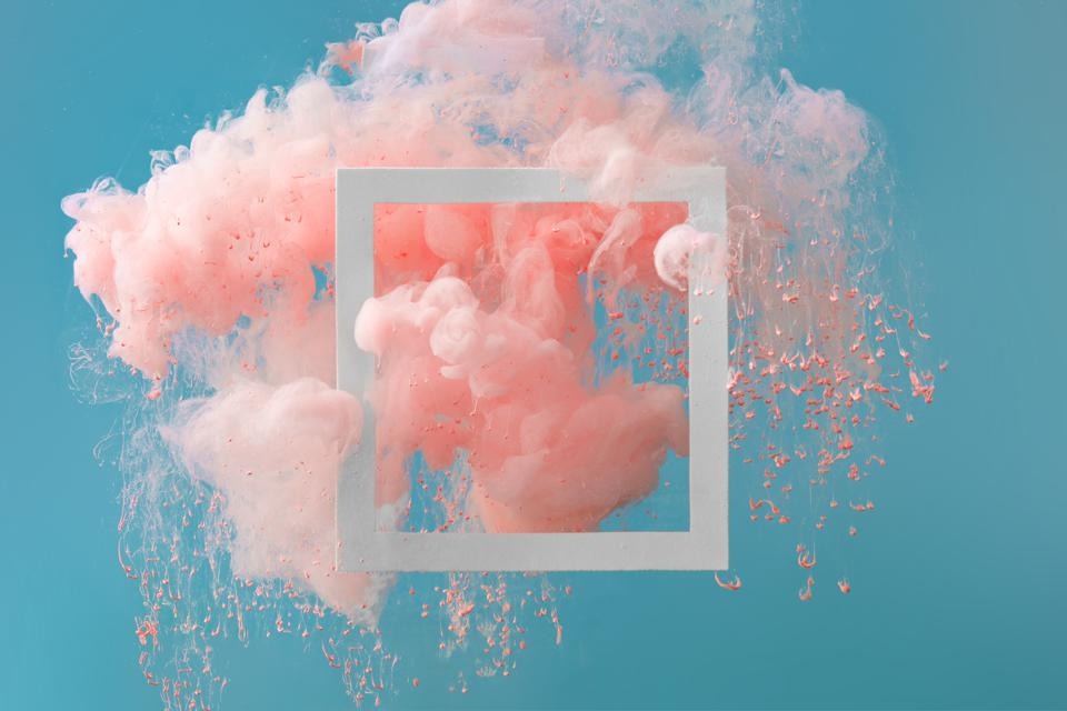 Pink cloud in a blue sky filtering outside a frame
