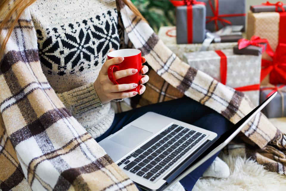 Woman shopping online preparing to christmas