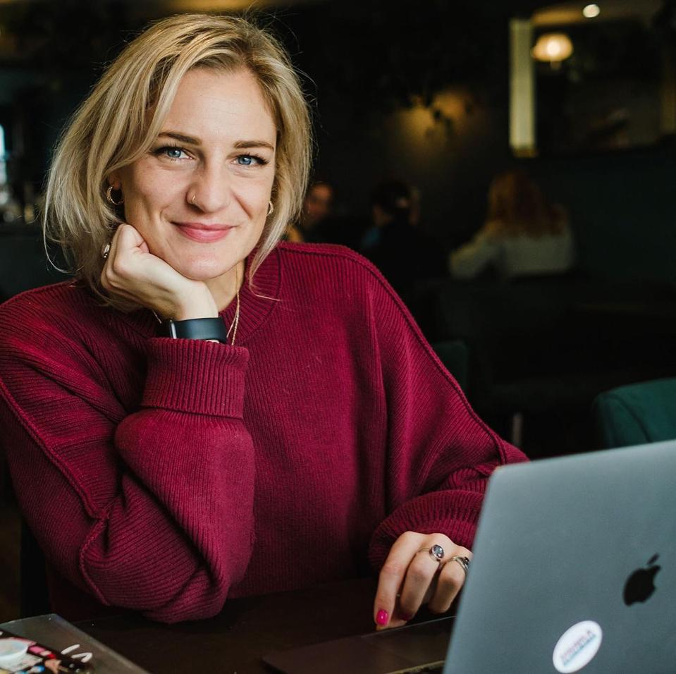 Found & Flourish founder Lara Sheldrake sits with her laptop on a desk in front of her