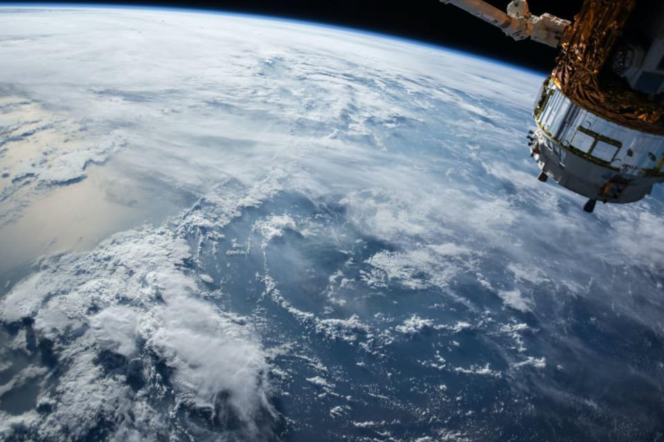 A satellite orbits the earth. New micro and nanosatellites are enabling a global internet of things (IoT) from space.