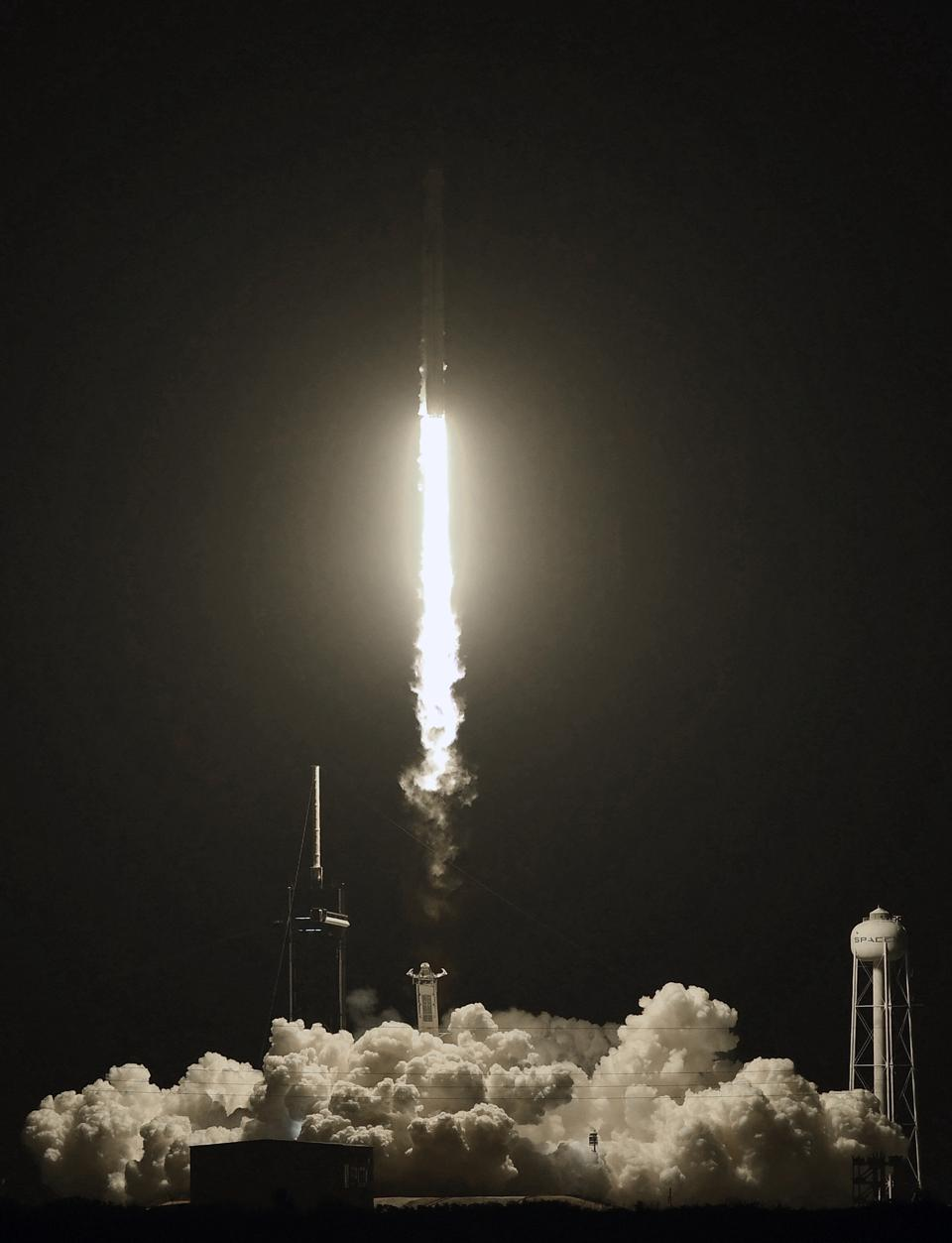 A SpaceX Falcon 9 rocket carrying the Crew Dragon spacecraft...