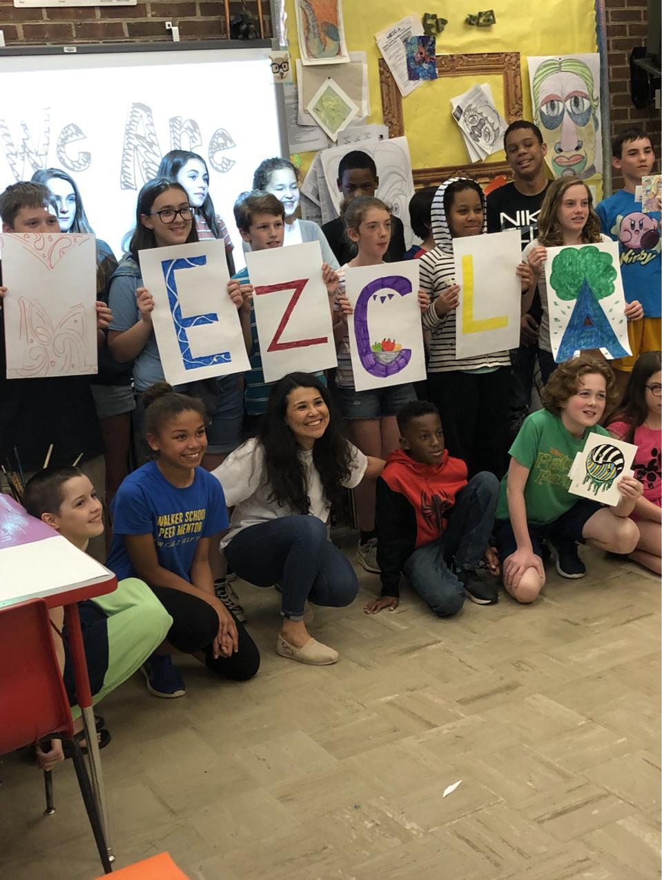 Mezcla facilitating an art class in Charlottesville, VA at Walker Upper Elementary.