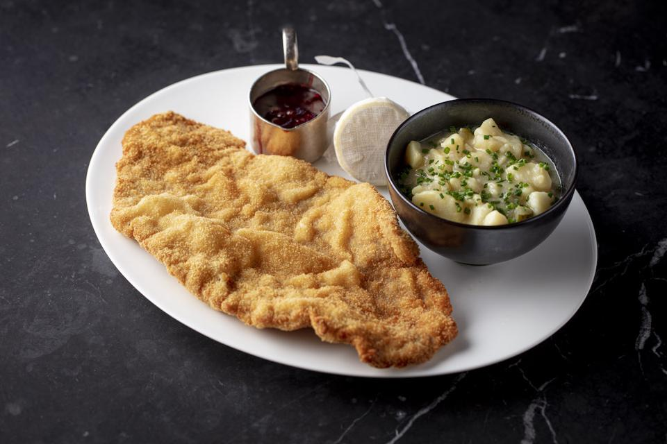 schnitzel on a platter with potatoes