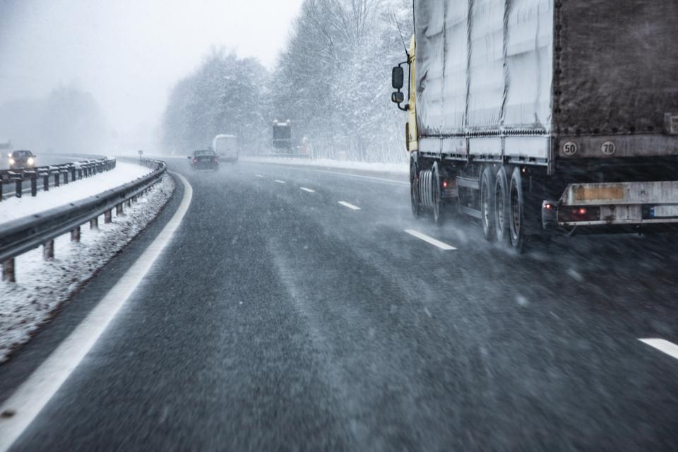 Truck Driving on Highway in Winter