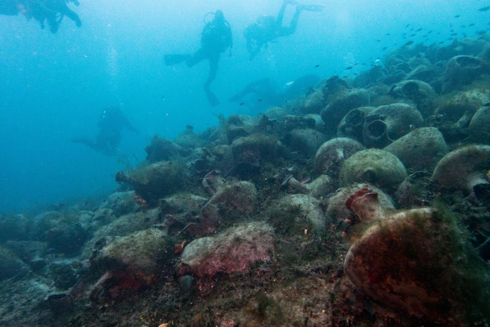 World's Best Destinations, National Geographic: Divers explore amphora from a fifth-century B.C. shipwreck in Greece