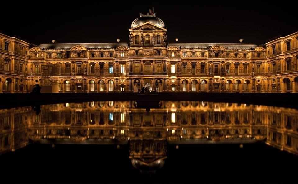 Louvre courtyard at night