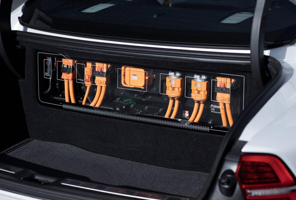 Orange hybrid power cables on display in the Polestar 1 car trunk