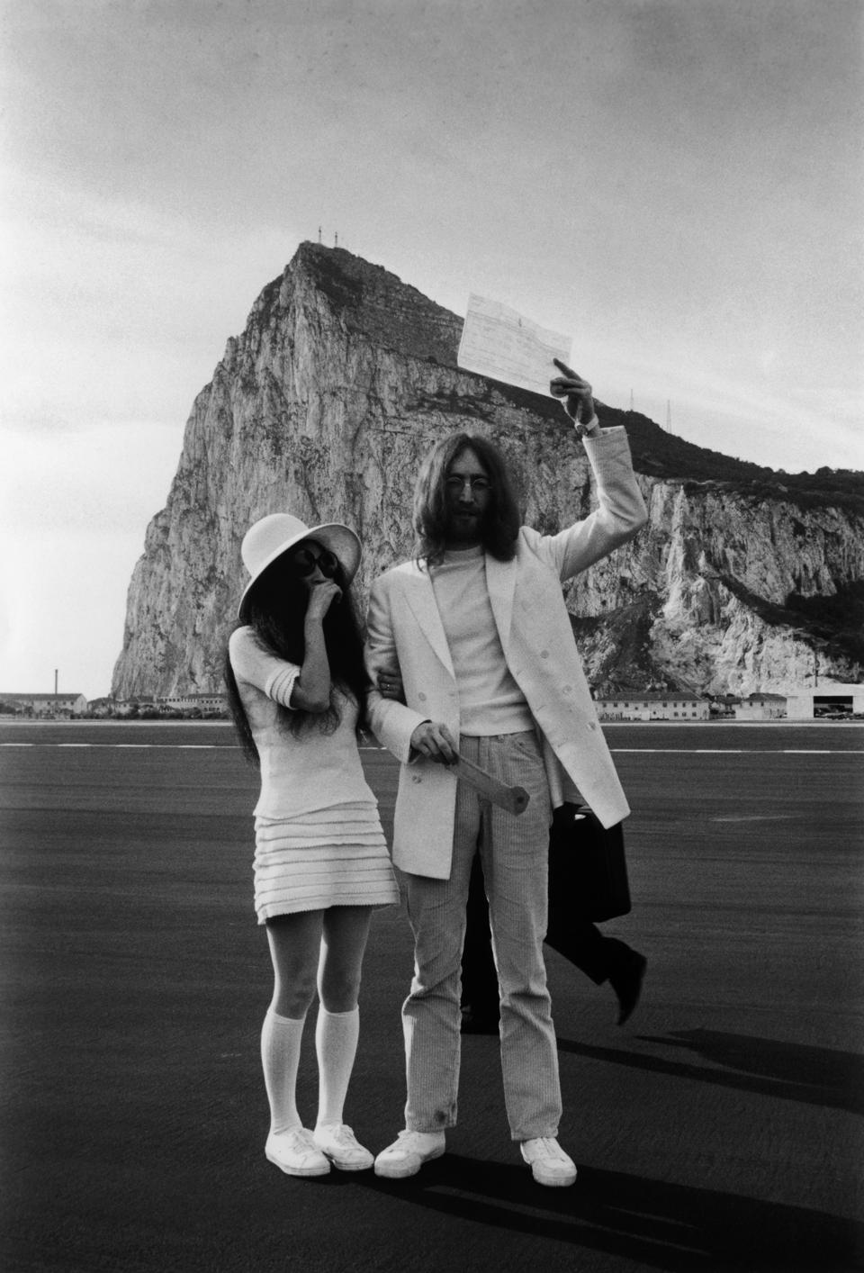 John Lennon and Yoko Ono with their marriage certificate after their wedding in Gibraltar, 20th March 1969.