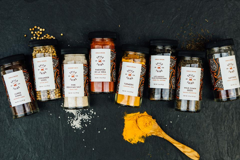 A close up of eight different Spice Tribe spices