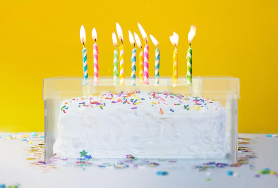 The Top It cake shield makes it safe to blow out birthday candles without spreading germs.