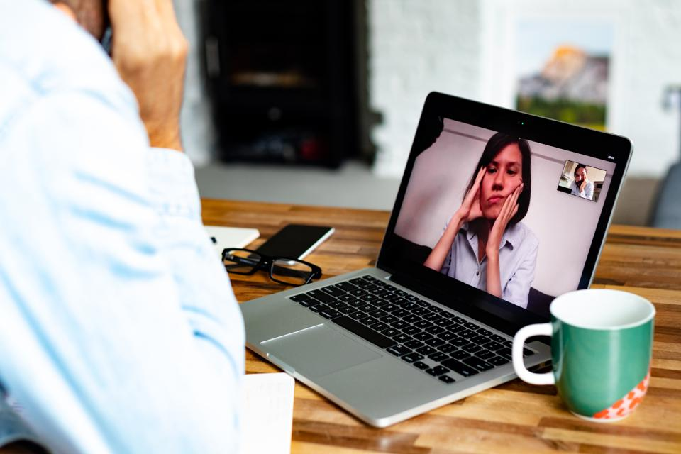 A man video conferencing with a woman
