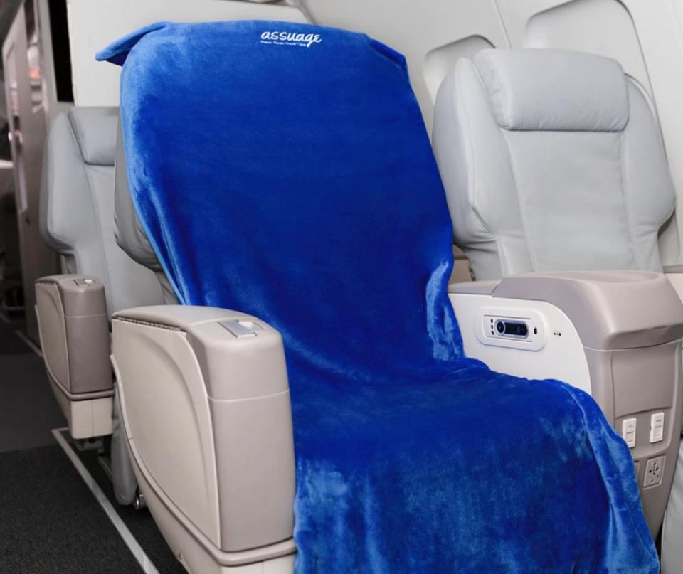 Cover your dirty airplane seat with this cozy protector.