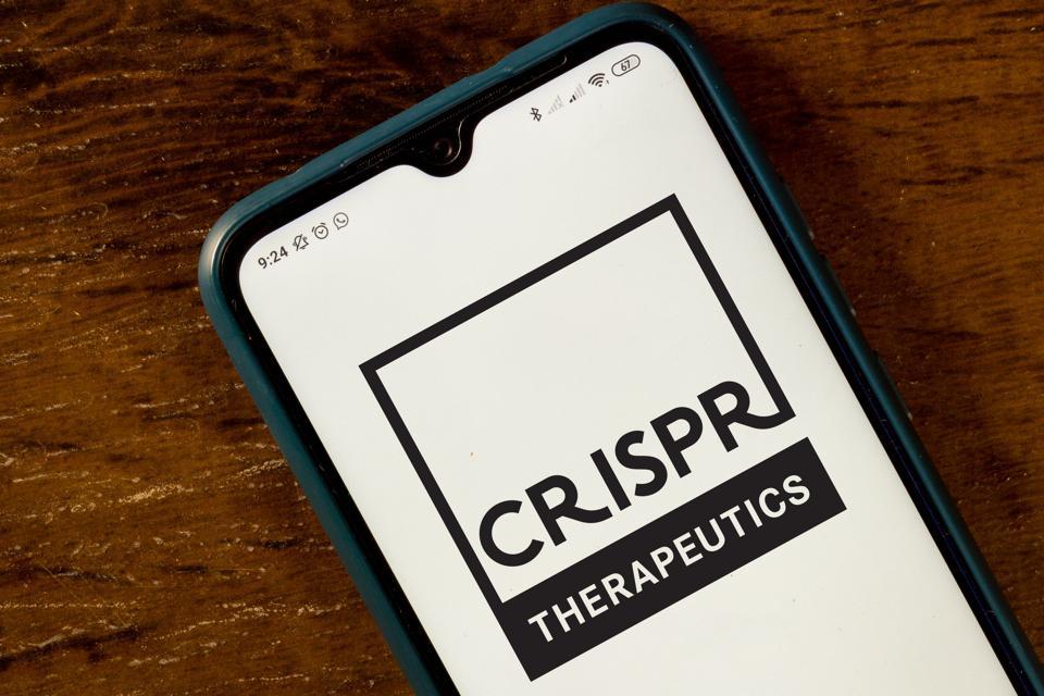 In this photo illustration the CRISPR Therapeutics logo seen...