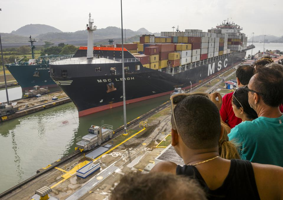 Tourists watching ships on the Panama canal