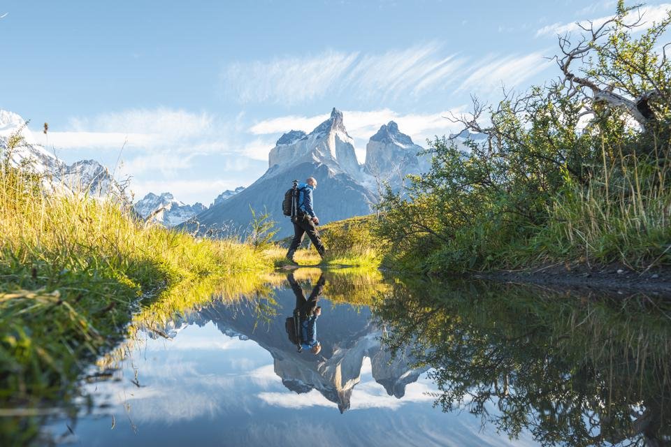Man crossing pond in Torres del Paine National Park, Chile Patagonia 6 places travel