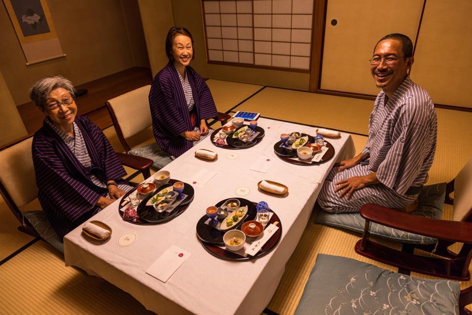 Japanese family enjoying Kaiseki  - a traditional Japanese...
