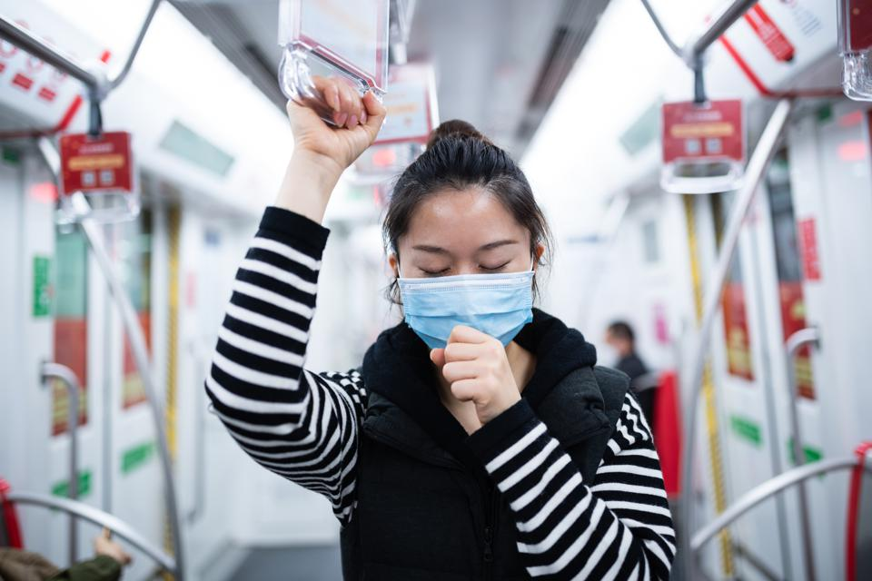 Woman with face mask on public transport