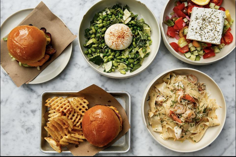 a burger, pasta with shrimp, veggie with burrata, greek salad with feta and waffle fries