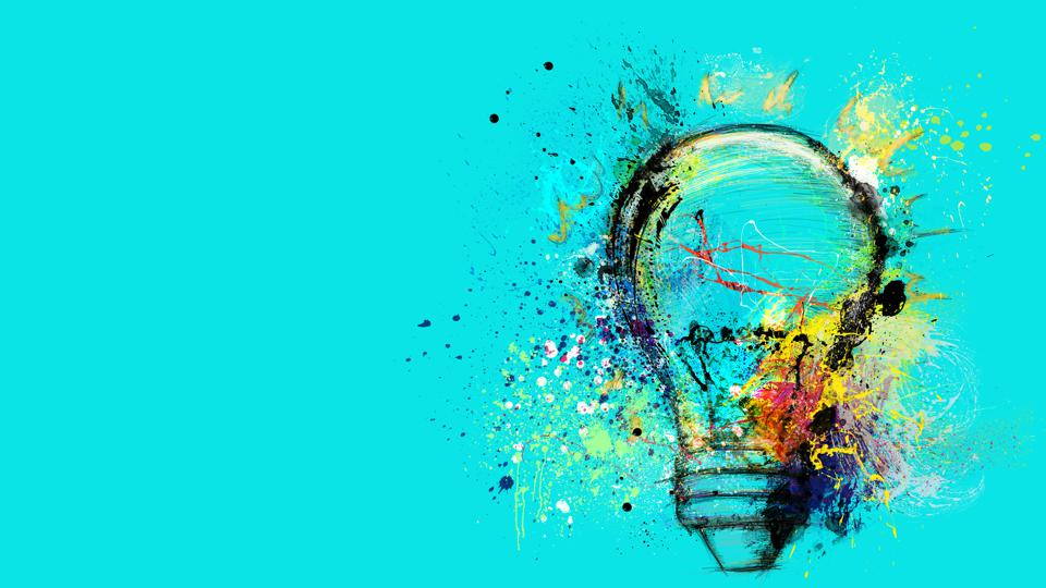 Big stylized light bulb on cyan background drawn with splashes of colored paint. Concept of innovation and creative thinking