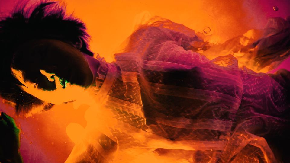 Still image of 0010x0010 video artwork 'Acid Bath.'
