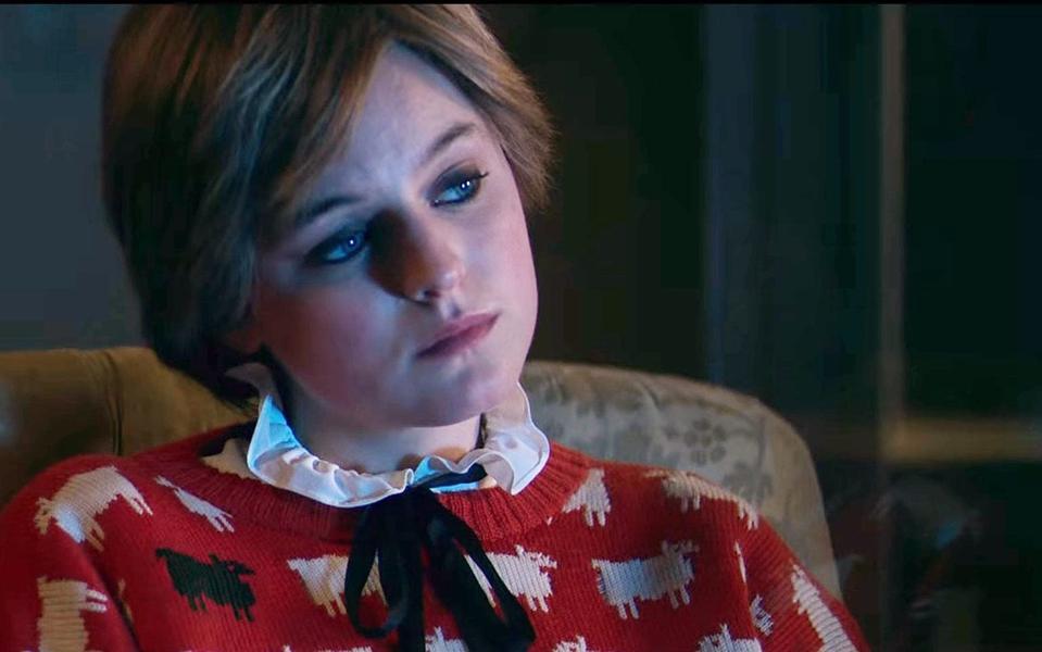 Emma Corrin as Diana, wearing the Princess' iconic sheep jumper