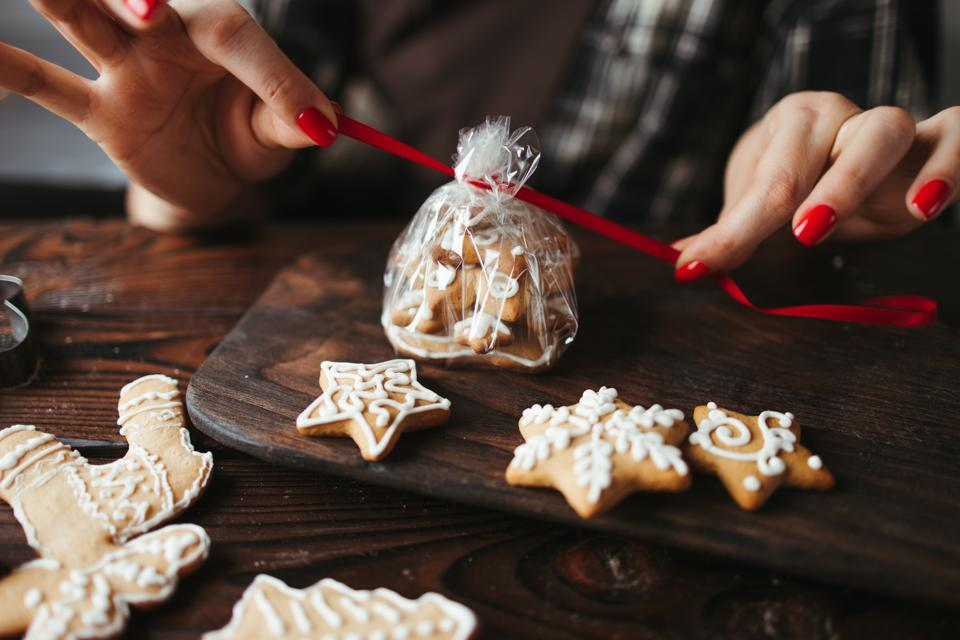 Woman packing Christmas gingerbread cookies