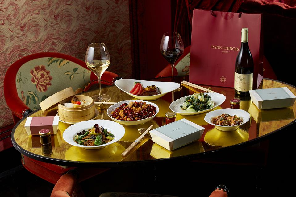 Chinese food and wine on a table