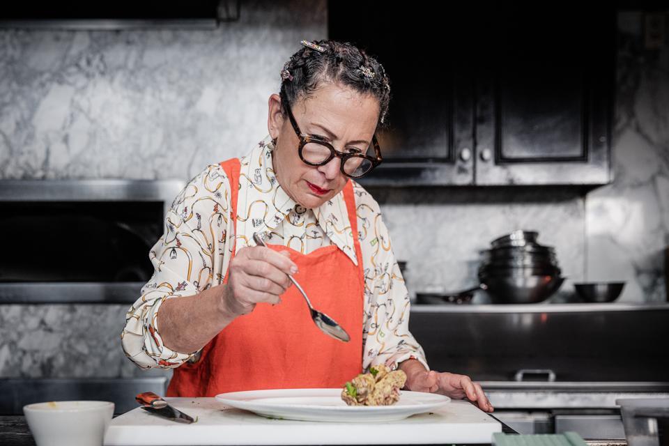 Close-up of chef Nancy Silverton preparing Italian food.