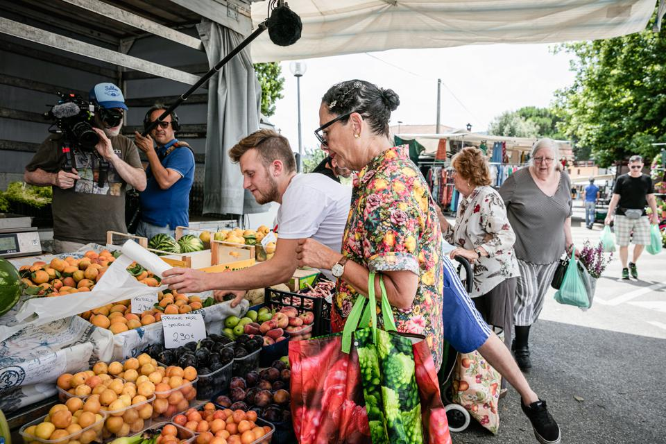 Chef Nancy Silverton being filmed at a fruit market for a documentary