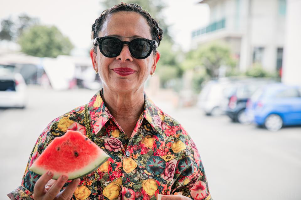 Close-up of Chef Nancy Silverton eating a slice of watermelon.
