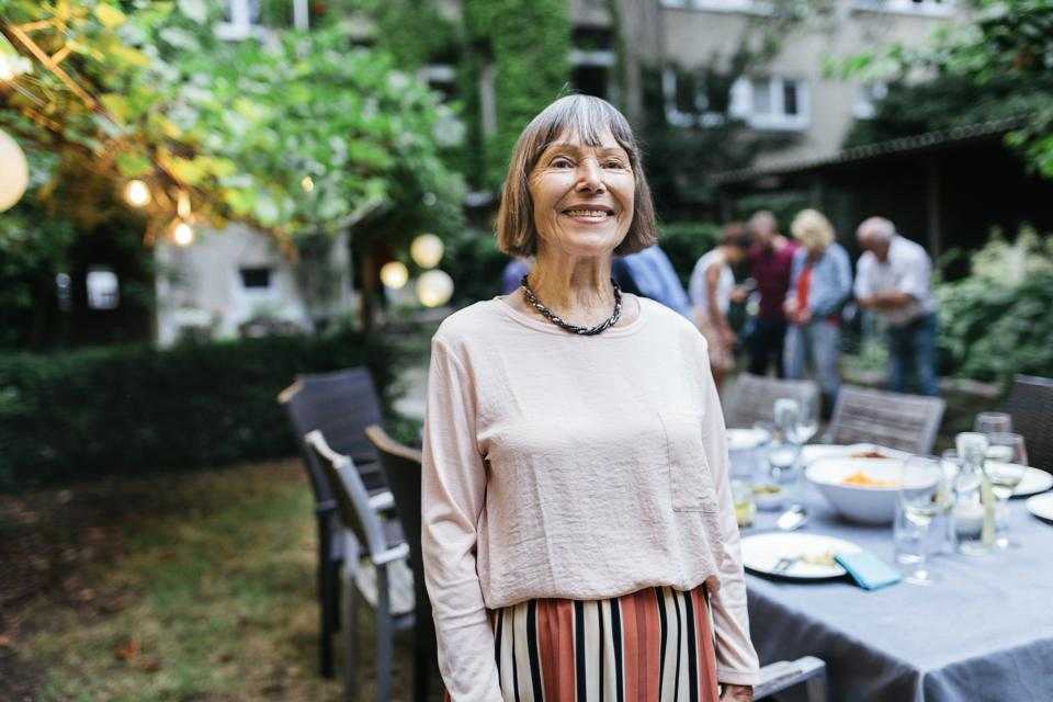 Portrait Of Elderly Woman Smiling After BBQ