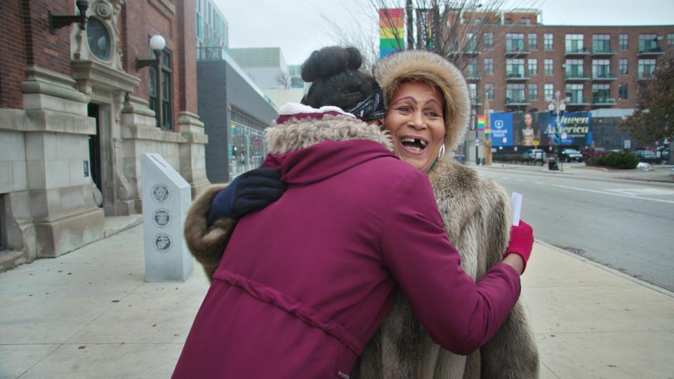 In a still shot from the documentary, Gloria Allen hugs a young transgender woman in the LGBTQ neighborhood of Chicago.