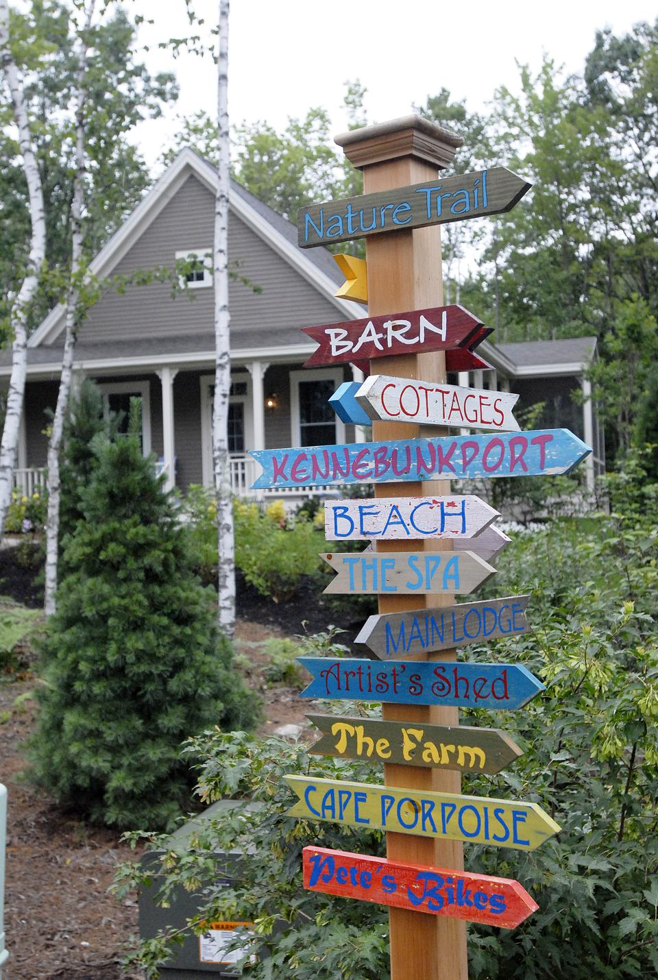 Signs point the way to the amenities at Hidden Pond in Kennebunkport with Fawn Pass Cottage in the...