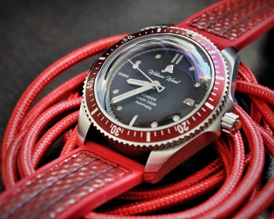 William Wood Valiant Red watch with recycled fire hose strap.