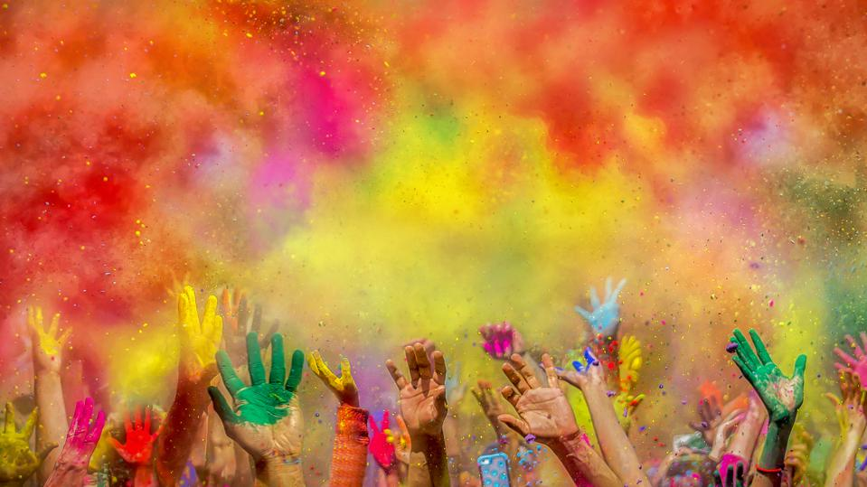 Painted hands at Holi festival, India