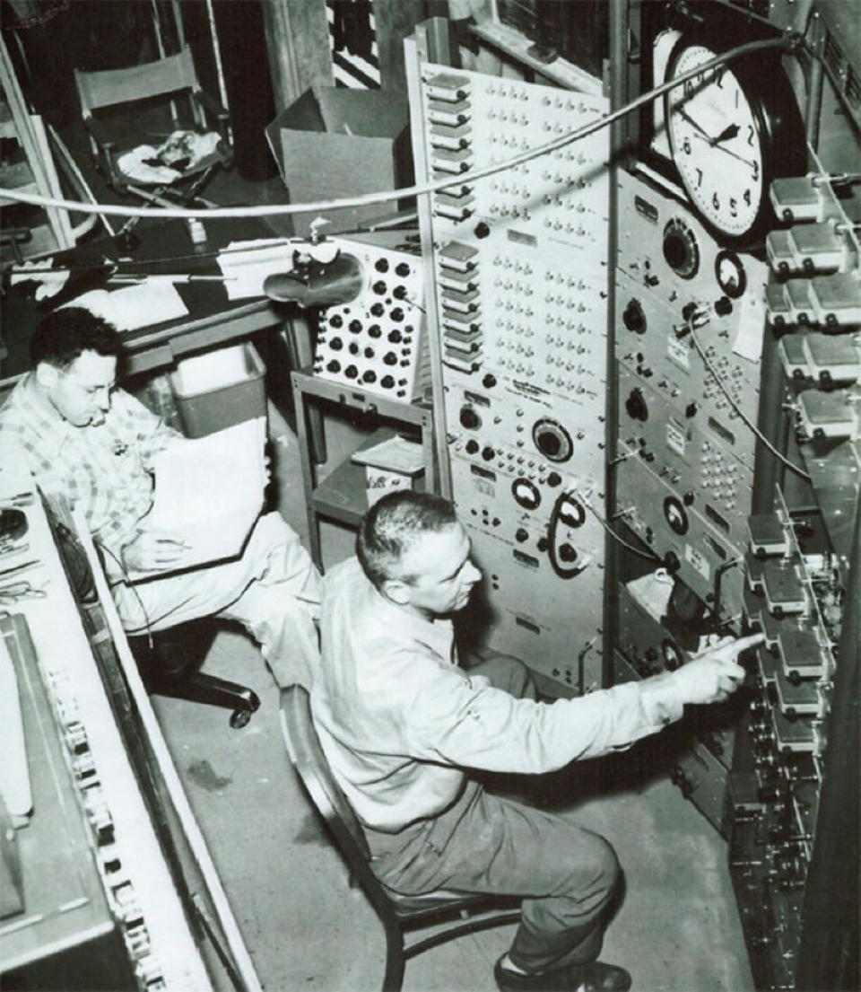 Fred Reines, left, and Clyde Cowan, right, at the Savannah River experiment's controls.