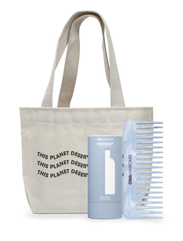 OWA Haircare's Clean Hair, Clean Planet Kit includes Moondust Collection: Hair Wash, The Less Baggage Tiny Tote, The Crystal Blue Comb.