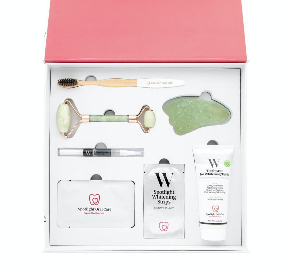 Spotlight Oral Care's Limited-Edition Ultimate Teeth Whitening System is a gift set collection featuring their Whitening Strips, Whitening Toothpaste, Whitening Mouthwash, Comforting Gum Oil, White Bamboo Toothbrush, and Lip masks. Plus one Gua sha and Anti-aging jade roller.