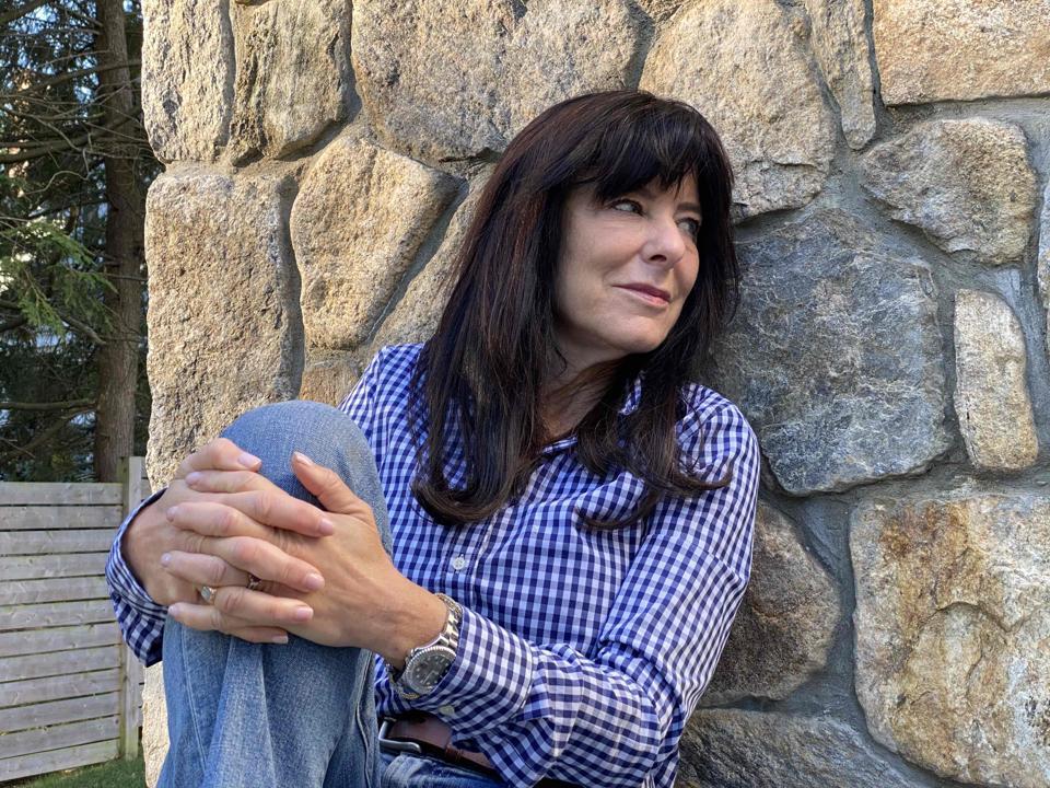Headshot of Hawley sitting against a rock wall