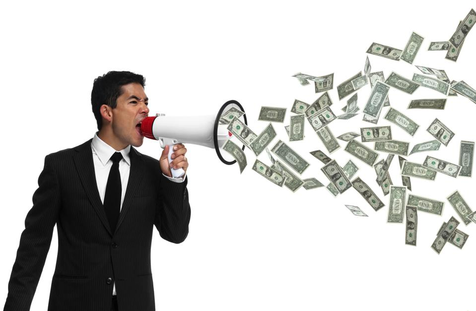 Businessman yelling into megaphone with money coming out of it
