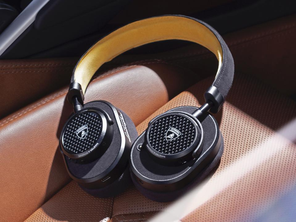 Master & Dynamic MW65 active noise-canceling wireless headphones on leather Lamborghini seat