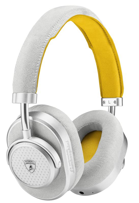 THree-quarter view of Master & Dynamic MW65 active noise-canceling wireless headphones in white and yellow finish.