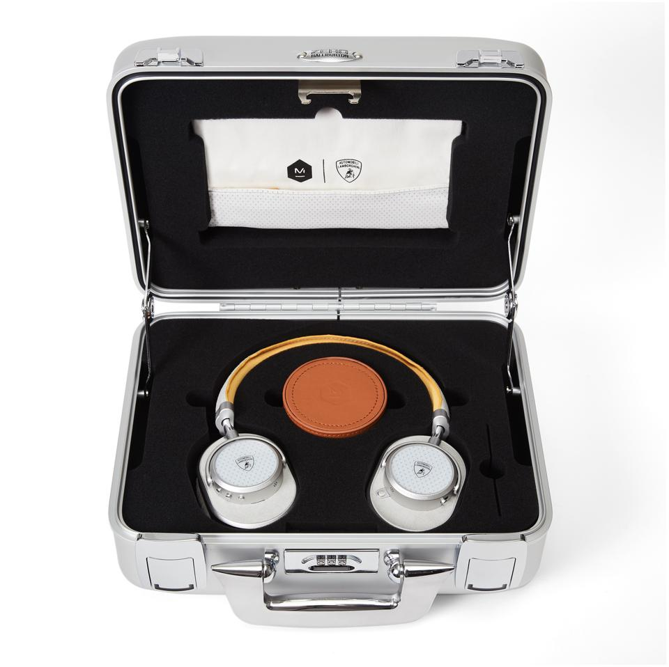Silver case open containing Master & Dynamic MW65 active noise-canceling wireless headphone